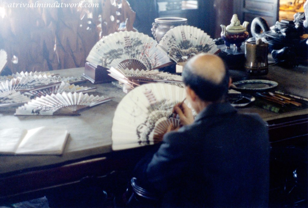 Hand painting fans at the Yellow Crane Tower