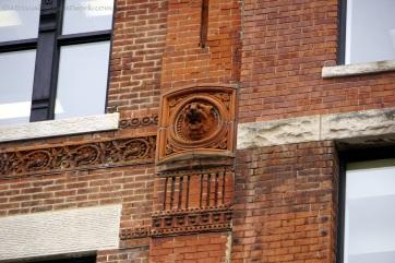 Gargoyle on apartment building.
