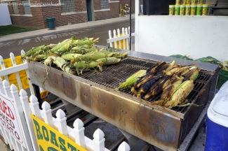 Roasting corn on the grill.