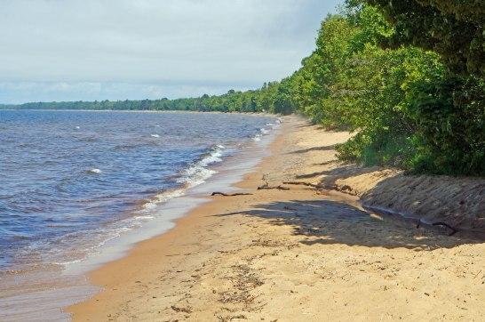 The beach on Whitefish Bay horseshoes around and to the horizon.